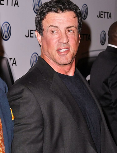 Actor Sylvester Stallone talks to reporters at a premier of his new film,